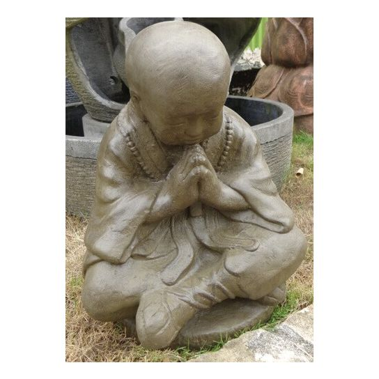 Comment placer une statue bouddha à l'extérieur d'une maison?